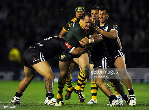 Matthew Scott of the Kangaroos is tackled by Sika Manu of the Kiwis during the Four Nations match between Australia and New Zealand at The Halliwell...