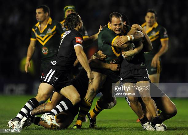 Matthew Scott of the Kangaroos is tackled by Sika Manu of the Kiwis during the Four Nations match between the Australia and New Zealand at The...