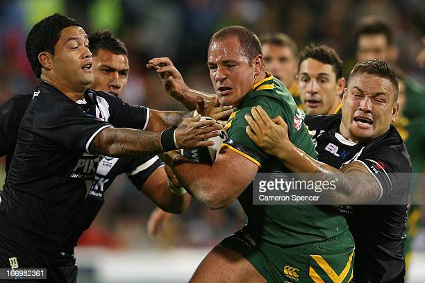Matthew Scott of the Kangaroos is tackled during the ANZAC Test match between the Australian Kangaroos and the New Zealand Kiwis at Canberra Stadium...