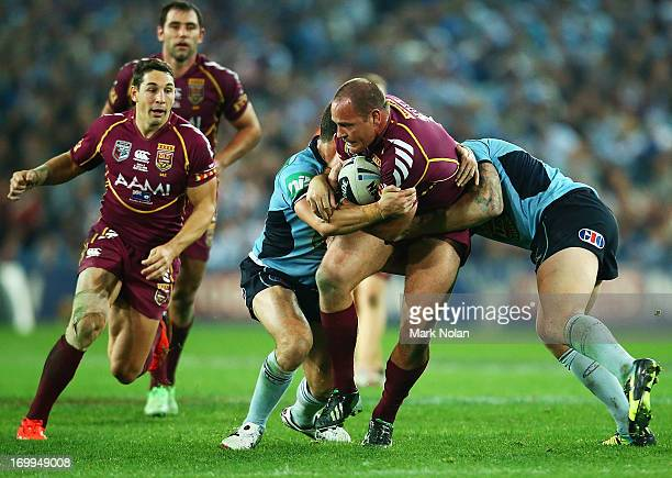 Matthew Scott of the Maroons is tackled during game one of the ARL State of Origin series between the New South Wales Blues and the Queensland...