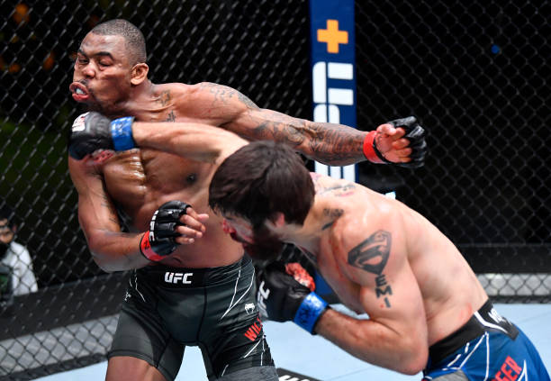 Matthew Semelsberger punches Khaos Williams in a welterweight bout during the UFC Fight Night event at UFC APEX on June 19, 2021 in Las Vegas, Nevada.