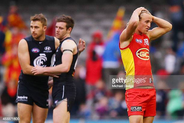 Matthew Shaw of the Suns reacts after their defeat during the round 20 AFL match between the Carlton Blues and the GOld Coast Titans at Etihad...