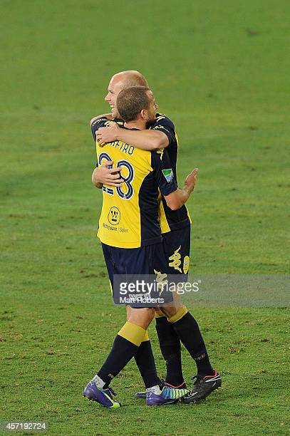 Matthew Sim of the Mariners celebrates kicking a goal with Glen Trifiro during the FFA Cup Quarter Final match between the Palm Beach Sharks and the...
