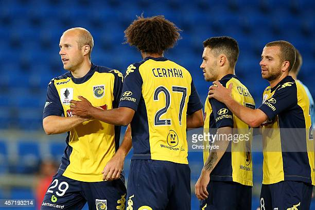 Matthew Sim of the Mariners celebrates with team mates after scoring a goal during the FFA Cup Quarter Final match between the Palm Beach Sharks and...