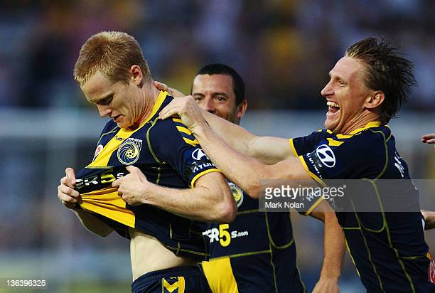 Matthew Simon and Daniel McBreen of the Mariners celebrate a goal by Simon during the round 13 midweek ALeague match between the Central Coast...