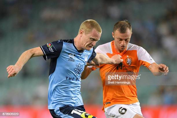 Matthew Simon of Sydney and Avram Papadopoulos of Brisbane contest the ball during the round eight ALeague match between Sydney FC and the Brisbane...