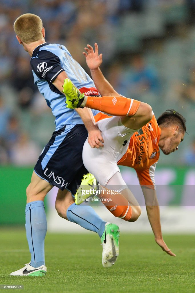 Matthew Simon of Sydney and Connor O'Toole of Brisbane collide during the round eight A-League match between Sydney FC and the Brisbane Roar at Allianz Stadium on November 25, 2017 in Sydney, Australia.