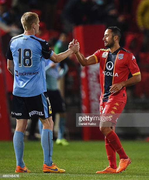 Matthew Simon of Sydney congratulates Tarek Elrich of United after the FFA Cup Round of 16 match between Adelaide United and Sydney FC at Coopers...