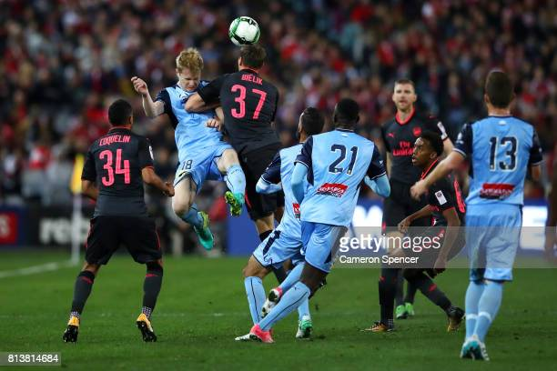 Matthew Simon of Sydney FC and Krystian Bielik of Arsenal contest the ball during the match between Sydney FC and Arsenal FC at ANZ Stadium on July...