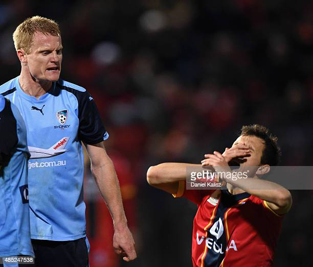 Matthew Simon of Sydney reacts to Isaas Snchez of United during the FFA Cup Round of 16 match between Adelaide United and Sydney FC at Coopers...