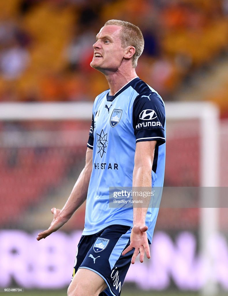 Matthew Simon of Sydney reacts to the referees decision to penalise him during the round 15 A-League match between the Brisbane Roar and Sydney FC at Suncorp Stadium on January 8, 2018 in Brisbane, Australia.