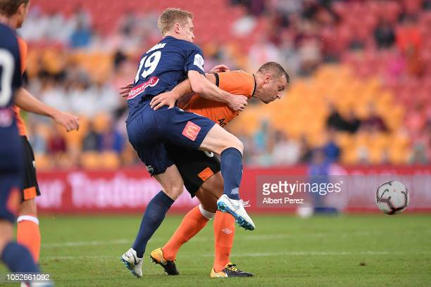 Matthew Simon of the Mariners and Avram Papadopoulos of the Roar compete for the ball during the round one ALeague match between the Brisbane Roar...