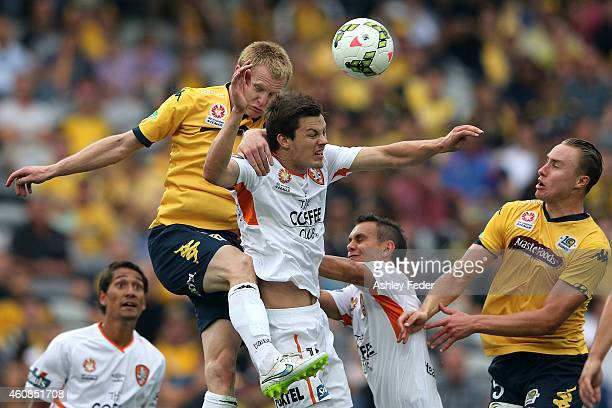 Matthew Simon of the Mariners contests the header against James Donachie of the Roar during the round 13 ALeague match between the Central Coast...