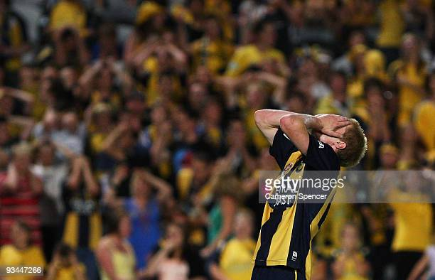 Matthew Simon of the Mariners reacts to an attempted kick at goal during the round 16 A-League match between the Central Coast Mariners and the Perth...