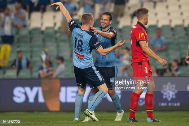 Matthew Simon of the Sydney celebrates scoring a goal with teammate Deyvison Rogerio da Silva Bobo during the round 26 ALeague match between Sydney...
