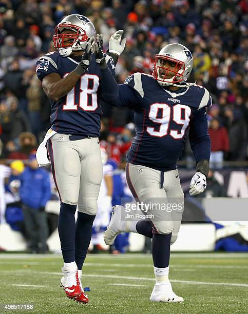 Matthew Slater and Dominique Easley of the New England Patriots react during the second quarter against the Buffalo Bills at Gillette Stadium on...