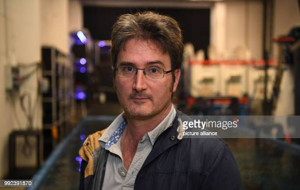 Matthew Slater head of aquacultural research at the Alfred Wegener Institute can be seen near the aquariums of the AWI in Bremerhaven Germany 20...