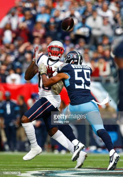Matthew Slater of the New England Patriots catches a pass from Tom Brady while defended by Wesley Woodyard of the Tennessee Titans during the first...