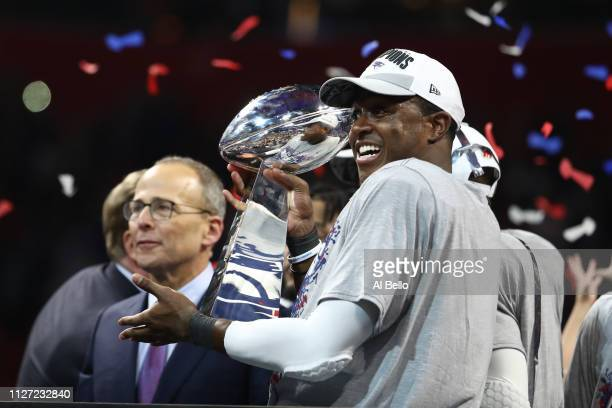 Matthew Slater of the New England Patriots celebrates with the Vince Lombardi Trophy after his teams 133 win over the Los Angeles Rams during Super...