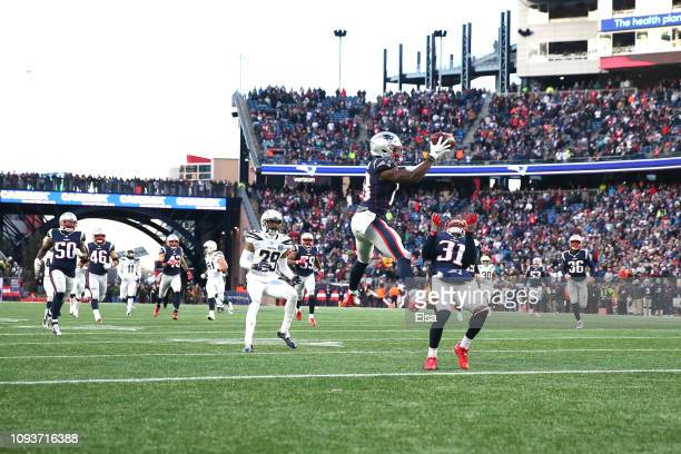 Matthew Slater of the New England Patriots downs a punt during the fourth quater in the AFC Divisional Playoff Game against the Los Angeles Chargers...