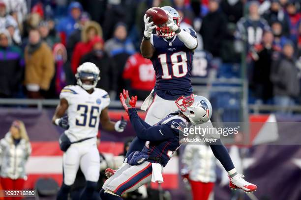 Matthew Slater of the New England Patriots intercepts a pass during the fourth quarter in the AFC Divisional Playoff Game against the Los Angeles...