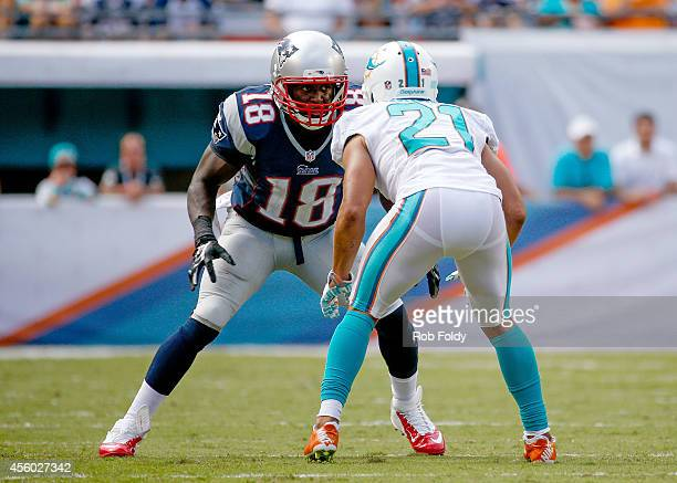 Matthew Slater of the New England Patriots is defended by Brent Grimes of the Miami Dolphins during the game at Sun Life Stadium on September 7 2014...