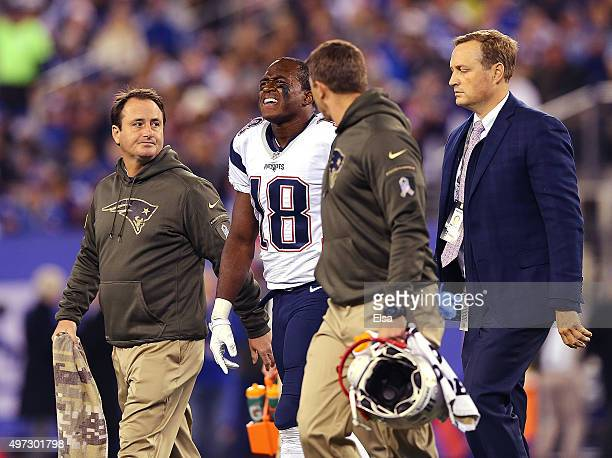 Matthew Slater of the New England Patriots is taken of the field by the training staff against the New York Giants during the first quarter at...