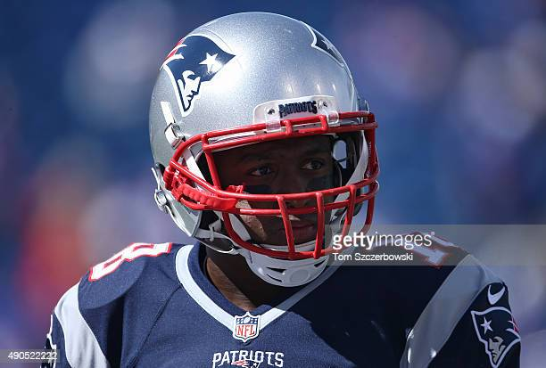 Matthew Slater of the New England Patriots warms up before the start of NFL game action against the Buffalo Bills at Ralph Wilson Stadium on...