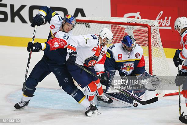 Matthew Smaby of Munich, Sam Marklund of Vaxjo and David Leggio of Munich during the Champions Hockey League Round of 32 match between Red Bull...
