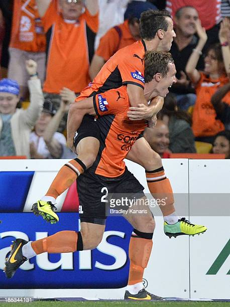 Matthew Smith and Liam Miller of the Roar celebrate a goal during the round two ALeague match between Brisbane Roar and Sydney FC at Suncorp Stadium...