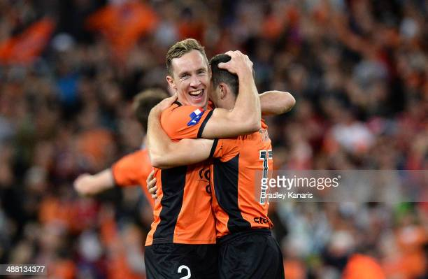 Matthew Smith and Matthew McKay celebrate victory as the full time siren sounds the 2014 A-League Grand Final match between the Brisbane Roar and the...