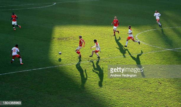 Matthew Smith of Charlton Athletic and Luke Garbutt of Blackpool challenge for the ball during the Sky Bet League One match between Charlton Athletic...