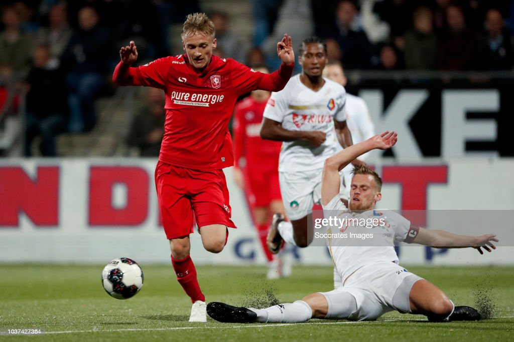 Matthew smith of fc twente toine van huizen of telstar during the