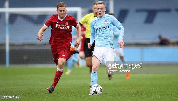 Matthew Smith of Manchester City and Herbie Kane of Liverpool during the UEFA Youth League QuarterFinal at Manchester City Football Academy on March...