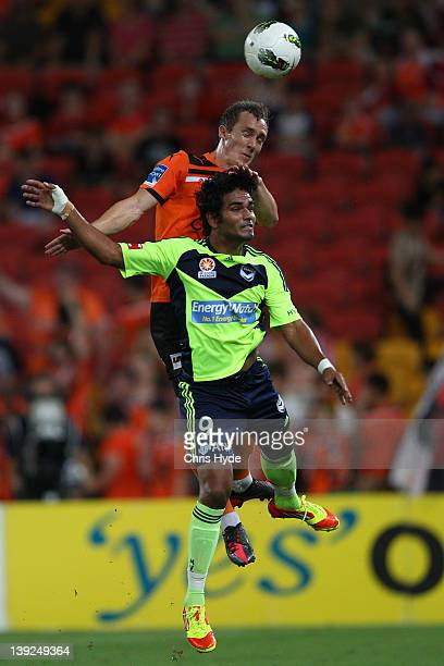 Matthew Smith of the Roar and Jean Carlos Solorzano of the Victory compete for the ball during the round 20 ALeague match between the Brisbane Roar...