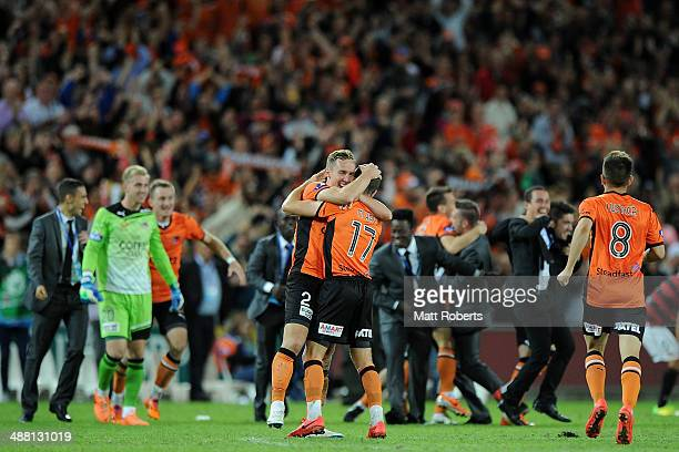 Matthew Smith of the Roar celebrates victory with Matt McKay after the 2014 ALeague Grand Final match between the Brisbane Roar and the Western...