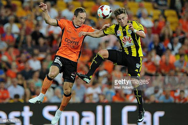 Matthew Smith of the Roar competes for the ball with Tyler Boyd of the Phoenix during the round 16 ALeague match between Brisbane Roar and the...