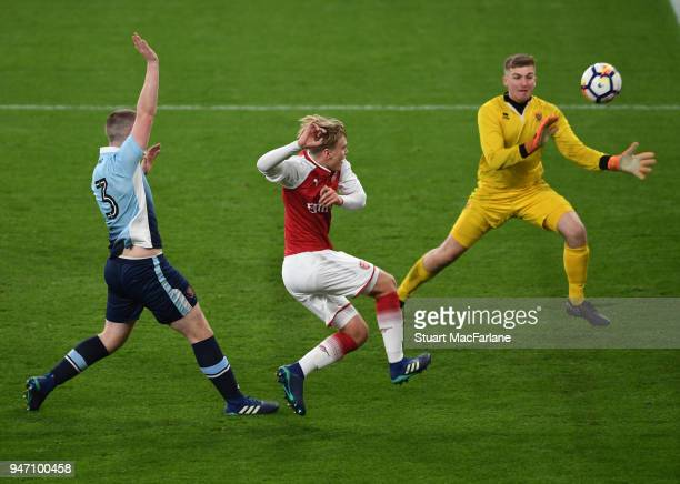 Matthew Smith shoots past Blackpool goalkeeper Craig Thordason to score the 5th Arsenal goal during the FA Youth Cup Semi Final 2nd Leg match between...