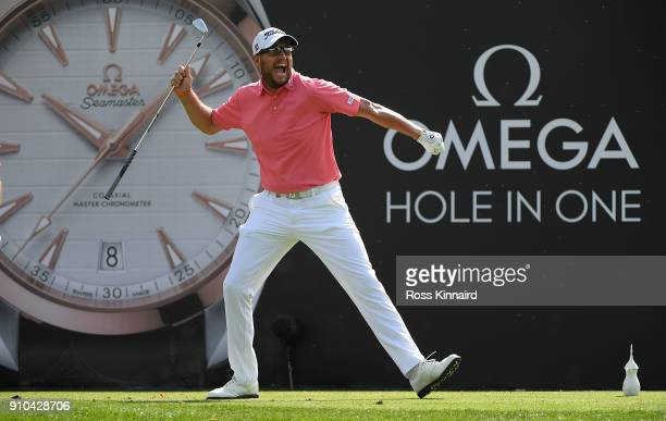 Matthew Southgate of England celebrates a hole in one on the 7th hole during round two of the Omega Dubai Desert Classic at Emirates Golf Club on...