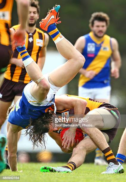 Matthew Spangher of Box Hill is tackled by Mitch Banner of Williamstown during the round 20 VFL match between Box HIll and Williamstown at Box City...