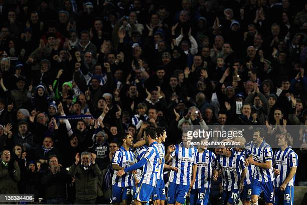 Matthew Sparrow of Brighton celebrates in front of the home fans with his team mates after scoring the second goal of the game during the npower...
