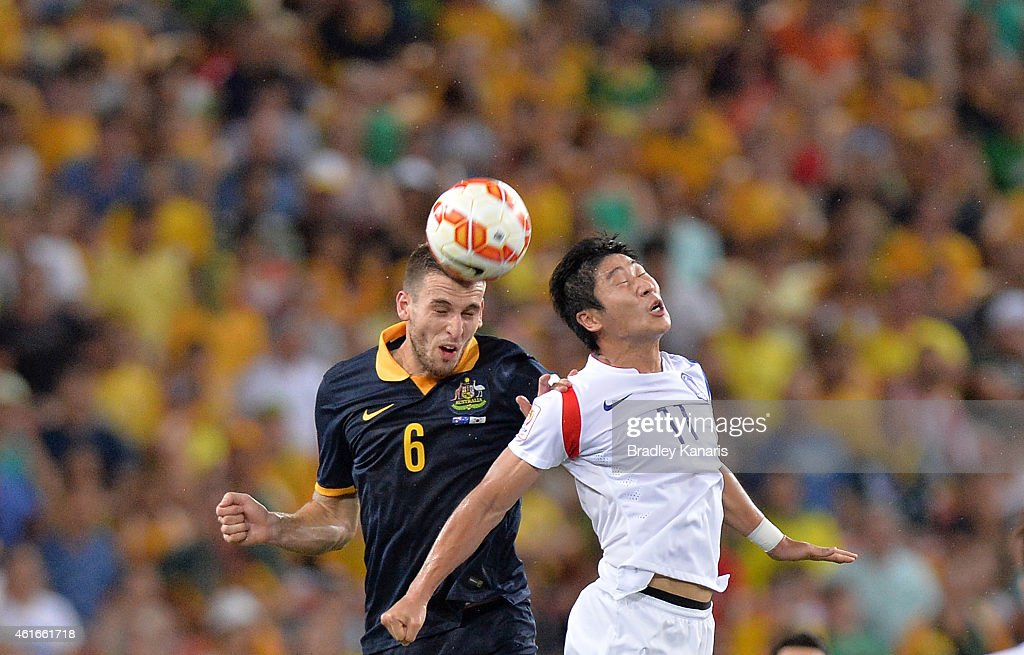 Matthew Spiranovic of Australia and Lee Keun Ho of Korea Republic compete for the ball during the 2015 Asian Cup match between Australia and Korea Republic at Suncorp Stadium on January 17, 2015 in Brisbane, Australia.
