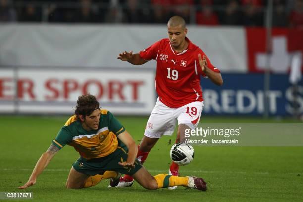 Matthew Spiranovic of Australia battles for the ball with Eren Derdiyokof Switzerland during an International friendly match between Switzerland and...