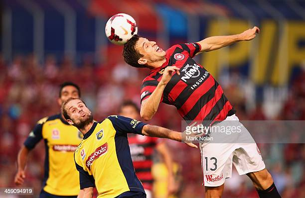 Matthew Spiranovic of the Wanderers and Marcel Seip of the Mariners contest possession during the round 11 A-League match between the Western Sydney...