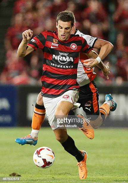 Matthew Spiranovic of the Wanderers is challenged by Besart Berisha of the Roar during the round 18 A-League match between the Western Sydney...