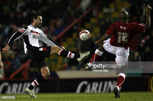 Matthew Spring of Charlton contests with Dele Adebola of Bristol during the CocaCola Championship match between Bristol City and Charlton Athletic at...