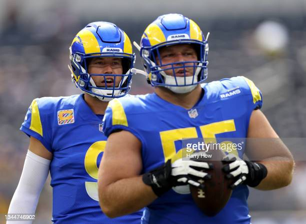Matthew Stafford and Brian Allen of the Los Angeles Rams warm up before the game against the Arizona Cardinals at SoFi Stadium on October 03, 2021 in...