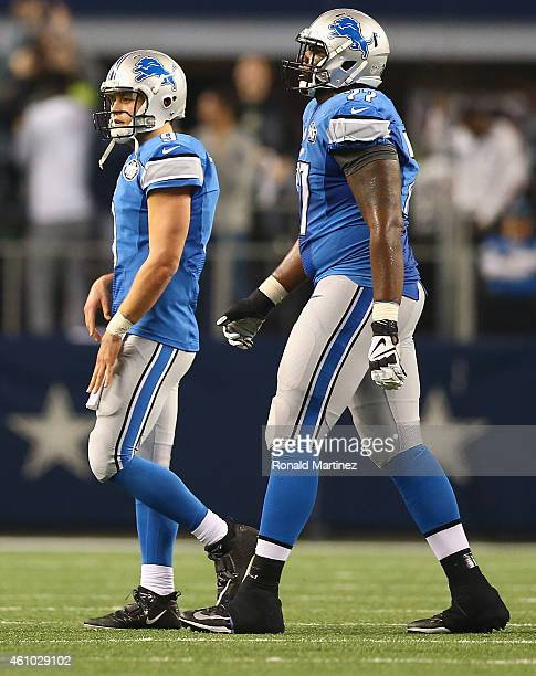Matthew Stafford and Cornelius Lucas of the Detroit Lions walk off the field after a fourth down attempt against the Dallas Cowboys in the fourth...