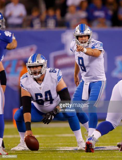 Matthew Stafford and Travis Swanson of the Detroit Lions in action against the New York Giants on September 18, 2017 at MetLife Stadium in East...