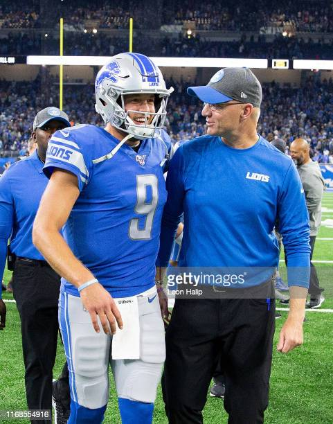 Matthew Stafford of the Detroit Lions and offensive coordinator Darrell Bevell celebrates a win over the Los Angeles Chargers at Ford Field on...